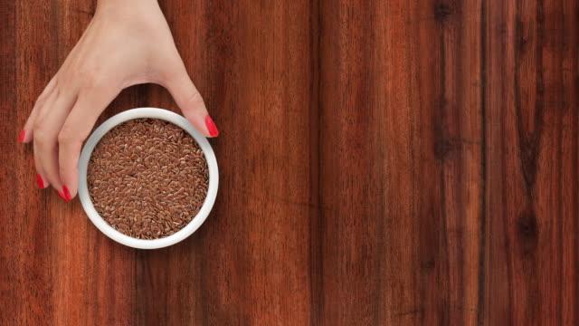 offering flax seeds - sfondo marrone video stock e b–roll