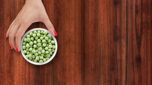 offering frozen green peas - frozen stock videos & royalty-free footage