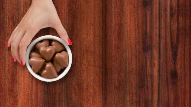 Offering heart shaped chocolates