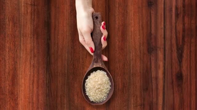 offering parboiled rice - sfondo marrone video stock e b–roll