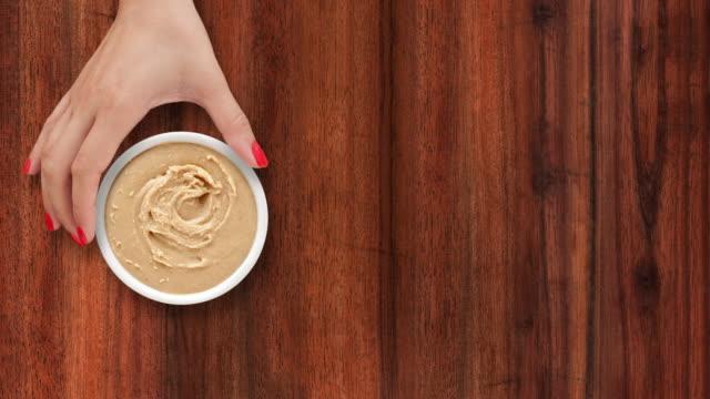 offering peanut butter - sfondo marrone video stock e b–roll