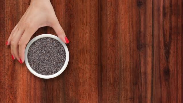 offering poppy seeds - sfondo marrone video stock e b–roll