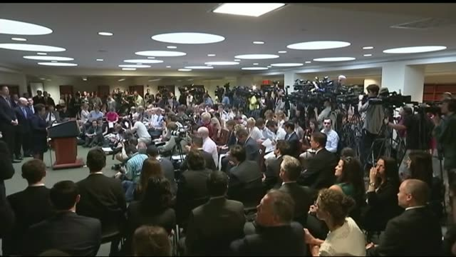 officals arrested on corruption charges; camera operators at press conference wide shot press conference screen showing loretta lynch being filmed - fifa stock videos & royalty-free footage