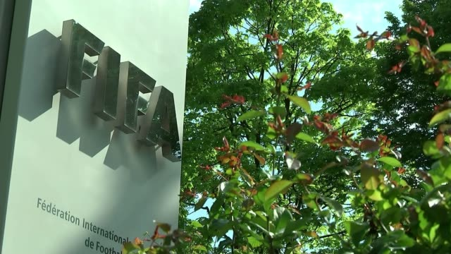 officals arrested on corruption charges; sign 'fifa' at fifa headquarters building banners flying outside fifa hq close shot 'fifa' banner tilt up - fifa stock videos & royalty-free footage