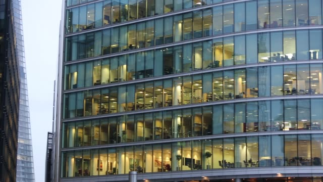 office blocks at more london with all the lights left on after the workers have gone home. - office block exterior stock videos & royalty-free footage