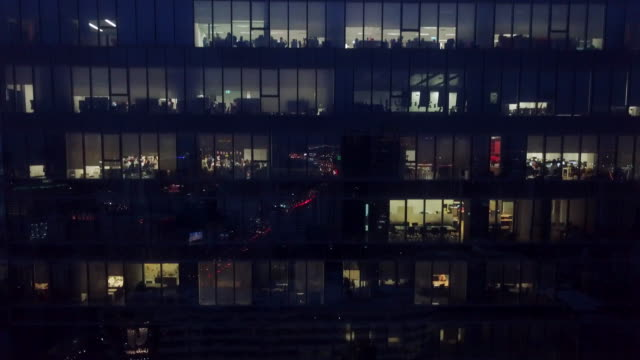 office building at night - overworked stock videos & royalty-free footage