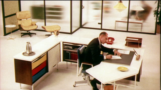 1958 WS ZI CU CS TU Office building, businessman sitting and signing documents in office designed by Herman Miller / USA / AUDIO