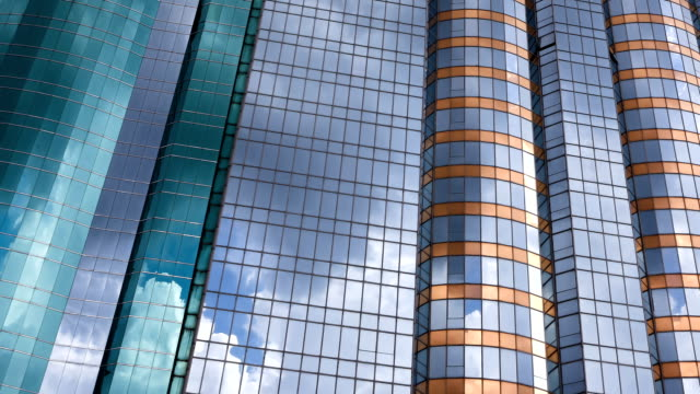 office building exterior reflects fast motion of clouds in sky, time lapse.