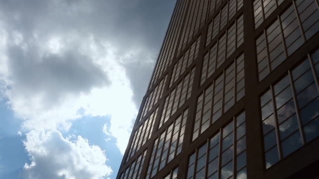Office building in the sun - time lapse
