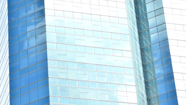 Office Building With Seamless Loop White Clouds TimeLapse