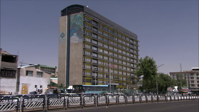WS Office building with traffic in foreground, Tehran, Iran
