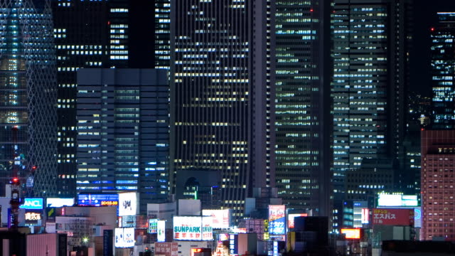 t/l cu ha office buildings and neon's, shinjuku, tokyo, japan - office block exterior点の映像素材/bロール