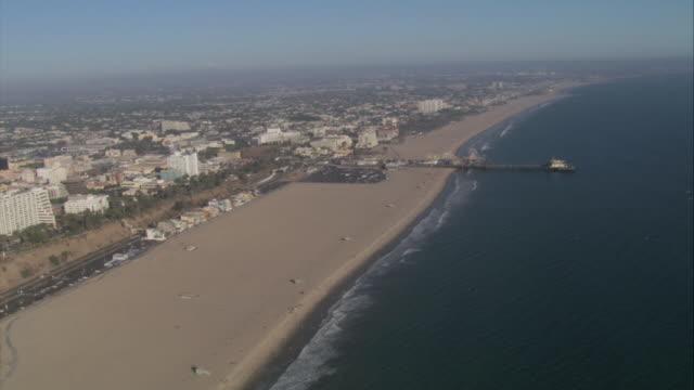 aerial office buildings approaching the beach and the ocean / santa monica, california, united states - 2007 bildbanksvideor och videomaterial från bakom kulisserna