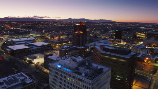 office buildings around albuquerque civic plaza before sunrise - albuquerque new mexico stock videos & royalty-free footage