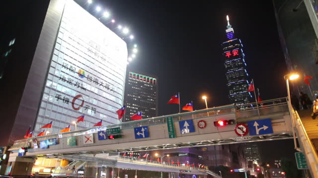 ws la office buildings illuminated at night / taipei, taiwan - taiwanese flag stock videos & royalty-free footage