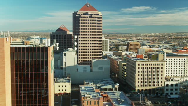 office buildings in downtown albuquerque early in the morning - drone shot - albuquerque new mexico stock videos & royalty-free footage