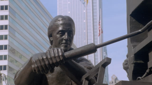 office buildings loom over a statue of benjamin franklin. - benjamin franklin stock videos & royalty-free footage