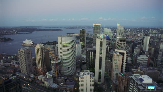 WS AERAIL POV Office buildings of large metropolitan city  / Sydney, Unspecified, Australia