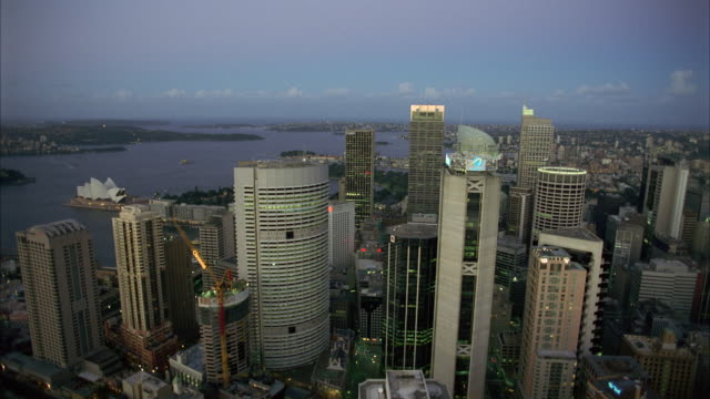 WS AERAIL POV Office buildings of large metropolitan city  / Sydney, Unspecified, Australia