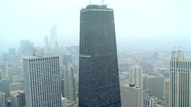 office buildings surround the john hancock building in downtown chicago. - downtown stock videos & royalty-free footage