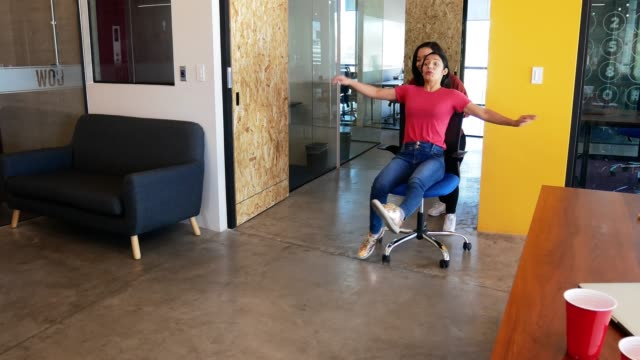 Office chair race in Mexican coworking space