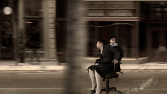 office chair street race - chair stock videos & royalty-free footage