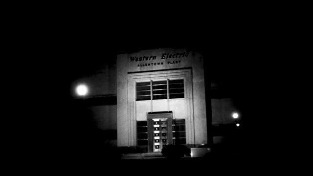 "office full of workers; people exiting the factory gate; stable view of building with sign ""western electric allentown plant"" at nighttime - 1940 1949 stock videos & royalty-free footage"