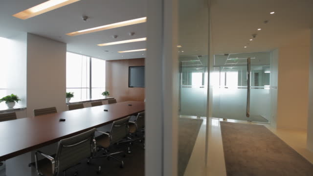 ds ws office hallway to empty conference room / china - conference table stock videos & royalty-free footage