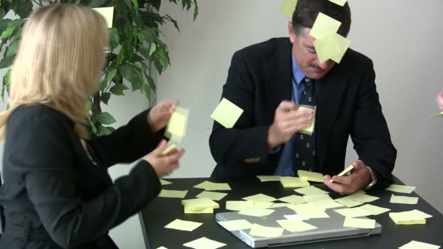 (hd1080i) office humor: speed of business - adhesive note stock videos & royalty-free footage