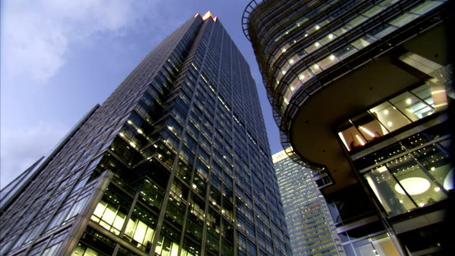 office lights illuminate the interiors of modern skyscrapers in london. available in hd. - skyscraper stock videos & royalty-free footage