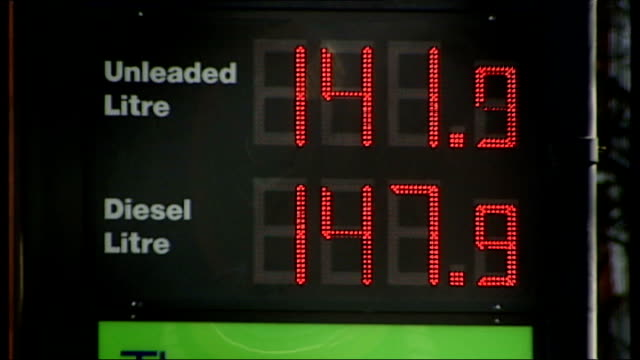 office of fair trading reviews petrol prices as 'fair' lib car at service station forecourt various shots of petrol station price signs showing... - unleaded stock videos and b-roll footage