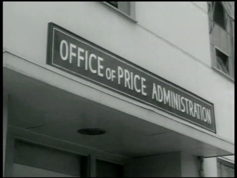 stockvideo's en b-roll-footage met office of price administration building sign office of price administration int narrow office w/ people working at desks leon henderson boarding bus... - 1942