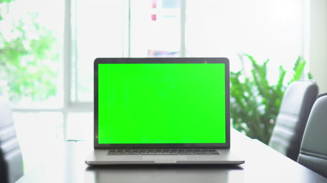 office shot of green screened laptop screen on desk,dolly shot - chair stock videos & royalty-free footage