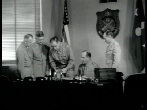 stockvideo's en b-roll-footage met office sign chief of ordnance int office unidentified chief of ordnance looking over paperwork from officers rifle stocks packed in case man taking... - 1943