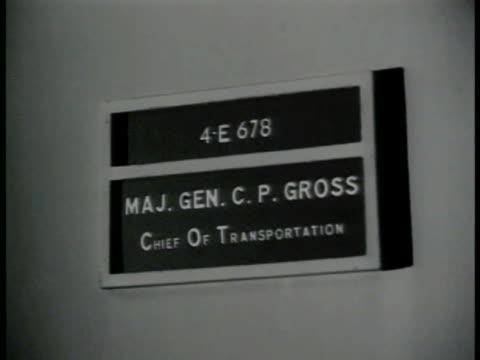 stockvideo's en b-roll-footage met transportation office sign chief of transportation maj gen cp gross int office w/ major general c p gross at desk meeting w/ other officers - 1943
