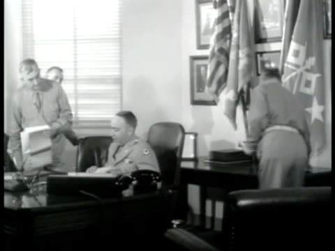 stockvideo's en b-roll-footage met office sign major general olmstead int office w/ major general dawson olmstead sitting at desk looking at paperwork talking w/ other officers wwii... - 1943