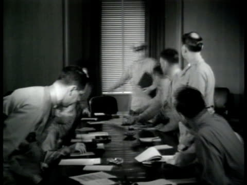 vídeos de stock, filmes e b-roll de office sign major general reybold int meeting room w/ officers sitting at table all rising as major general reybold enters ms officer engineers ms... - 1943
