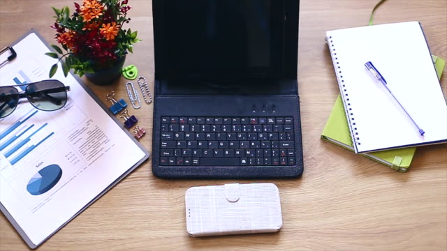 Office supplies and gadgets on wooden table