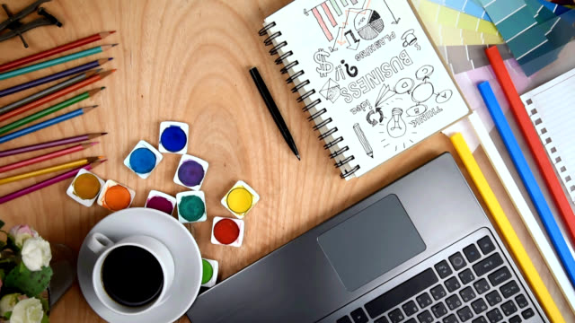 office table with laptop, goal of business illustration on notebook, cup of coffee, folders / business conceptual - table top view stock videos & royalty-free footage