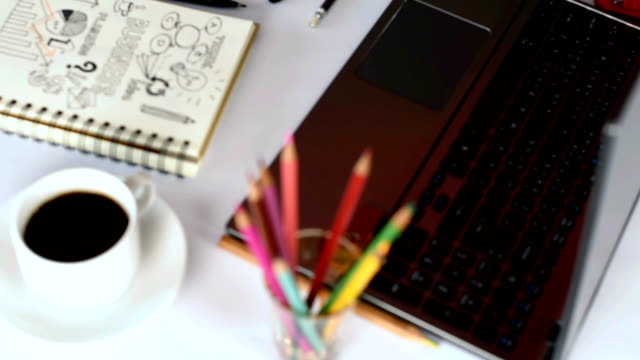 office table with laptop, notebook, cup of coffee/ business conceptual - colored pencil stock videos and b-roll footage