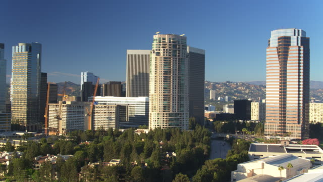 office towers and shopping mall in century city, los angeles - aerial pan - century city stock videos & royalty-free footage
