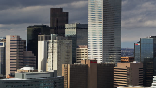 office towers in downtown denver on a cloudy evening - aerial - denver stock videos & royalty-free footage