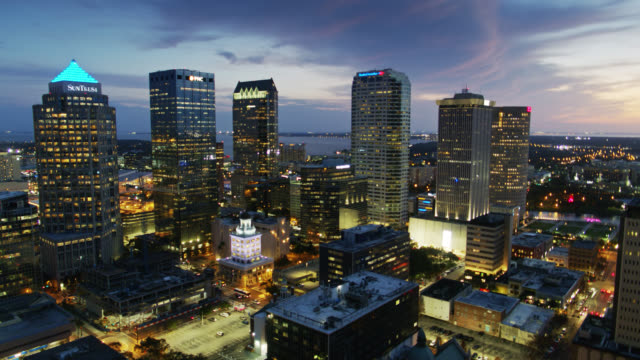 office towers in downtown tampa illuminated at twilight - aerial - tampa stock videos & royalty-free footage