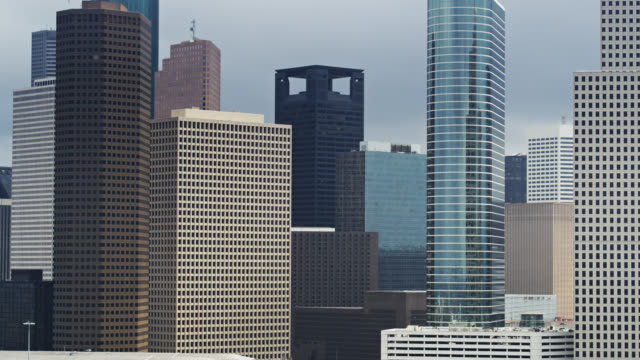 office towers in houston - aerial - downtown stock videos & royalty-free footage