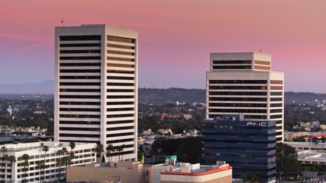 office towers in westwood, los angeles - aerial - westwood neighborhood los angeles stock videos & royalty-free footage