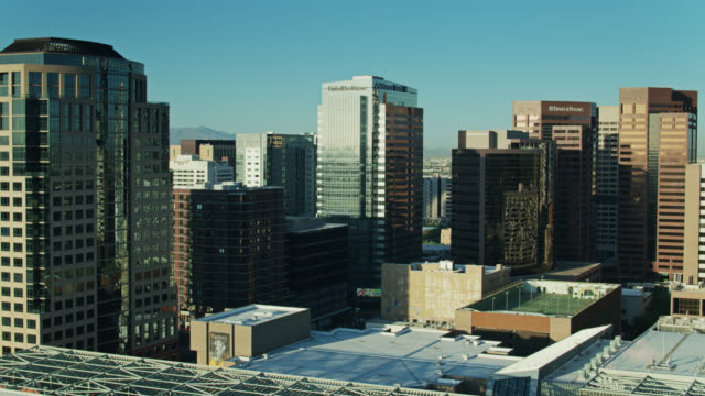 office towers shimmering in morning light in downtown phoenix - drone shot - phoenix arizona stock videos & royalty-free footage