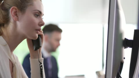 office woman on phone - desk stock videos & royalty-free footage
