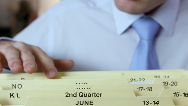 vídeos y material grabado en eventos de stock de office worker filing document - camisa y corbata