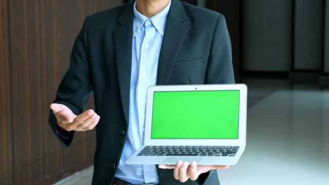 Office Worker using Notebook with Green Screen