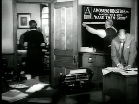 office workers bulletin planning brainstorming paper work cu plans for amoskeag mills ms exmanchester mayor arthur moreau talking w/ men new hampshire - paper industry stock videos & royalty-free footage